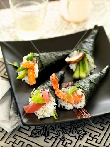Temaki sushi on a black plate