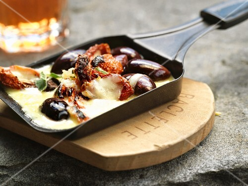Raclette with dried tomatoes and olives