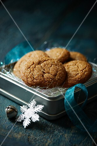 A tin of gingerbread biscuits to be given as a gift