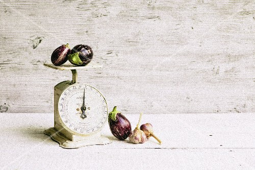 Aubergine and garlic on a vintage pair of scales