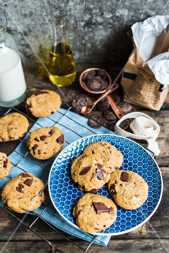 Chocolate chip cookies made with olive oil on a blue plate