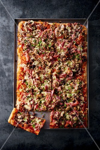 Pizza picante on a baking tray