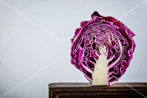 Half a red cabbage on a wooden board