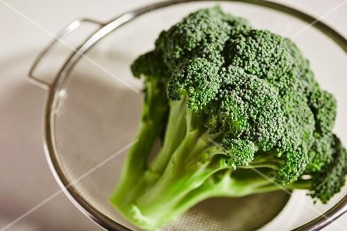 Fresh broccoli in a glass bowl
