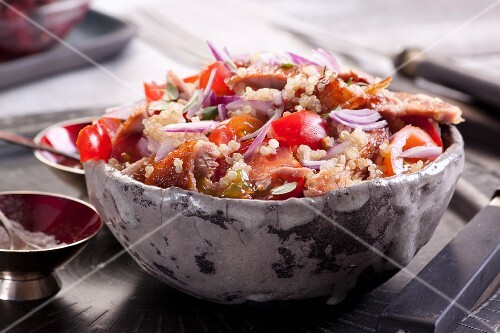 Quinoa salad with roast goose tomatoes and onion