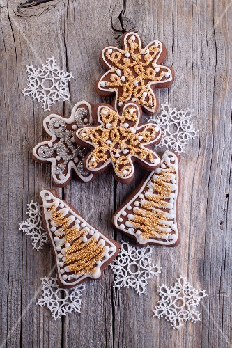 Christmas gingerbread biscuits (in the shape of stars and bells) on a wooden surface