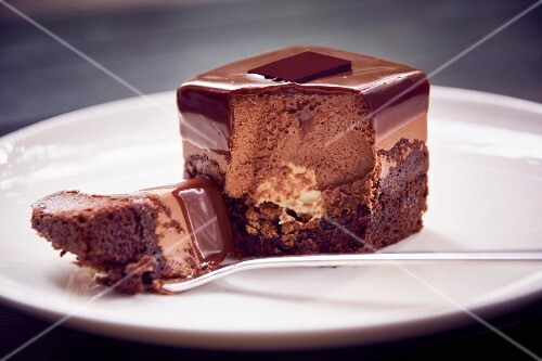 A chocolate petit four that has been bitten into