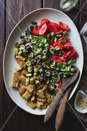 Panzanella with roasted aubergine, capers, olives and pine nuts (gluten-free)