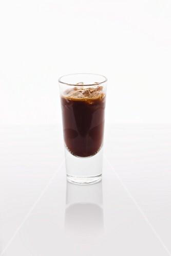 A shot of iced espresso