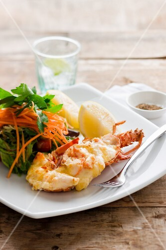 Lobster with lemon and salad