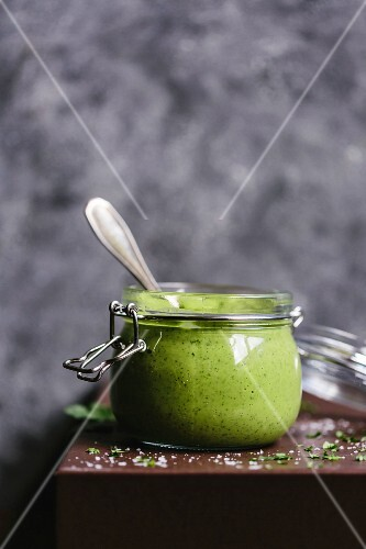 A jar of creamy avocado salad dressing