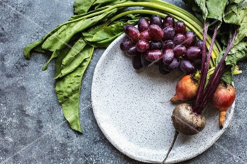 Freshly picked red and yellow beetroot and red grapes