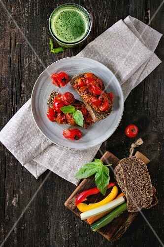 Italian tomato bruschetta with baked cherry tomatoes and sliced vegetables