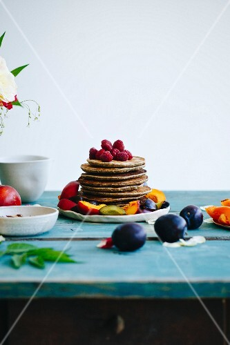 Pancakes on the green wooden table