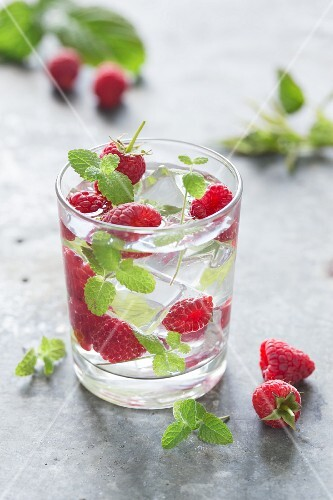 Water with raspberries, mint and ice cubes