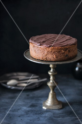A chocolate cheesecake with chocolate ganache