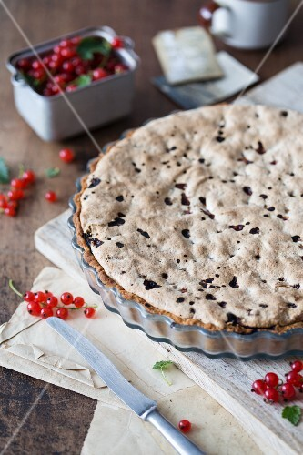 Redcurrant & almond tart in a baking tin