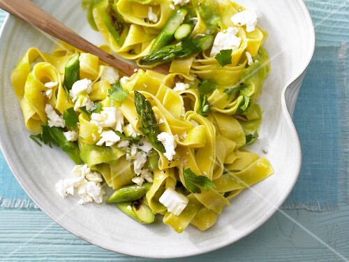 Flat ribbon pasta with green asparagus and sheep's cheese