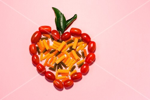 Assorted colourful pasta in a tomato heart