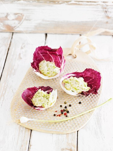Cashew nut cream with young garlic in radicchio leaves