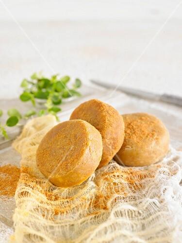 Vegan macadamia nut cheese with tomato powder