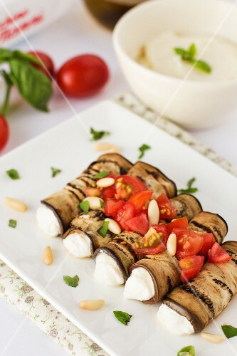 Aubergine rolls with ricotta, tomatoes and pine nuts