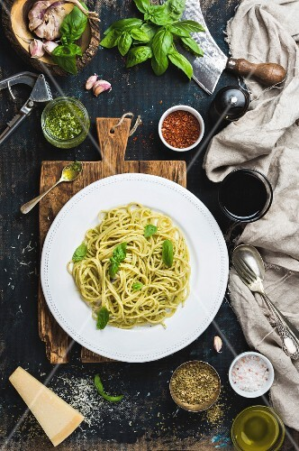Spaghetti with pesto sauce and fresh basil, Parmesan cheese and spices