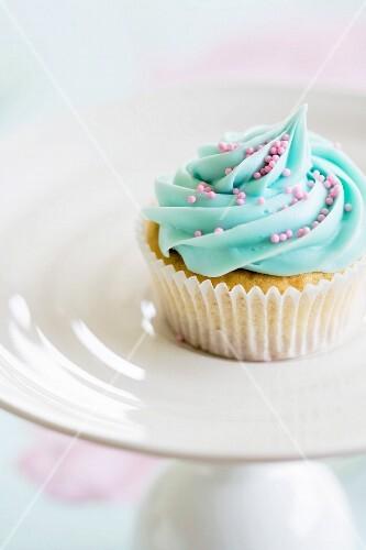 Cupcake decorated with pink sugar sprinkles