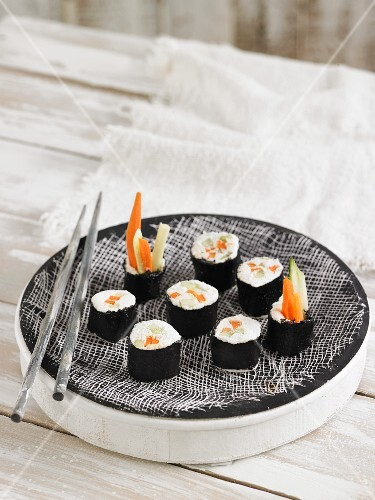 Vegan sushi with macadamia cream cheese, carrots and cucumber