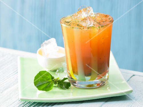 Carrot cocktail with nasturtium leaves