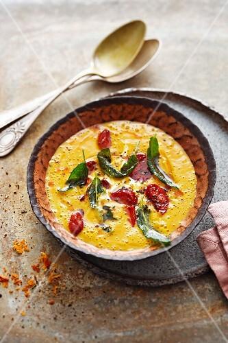 Sweet potato soup with sage and salami