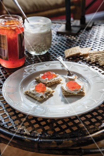 Crackers with home-made cream cheese, honey and jam