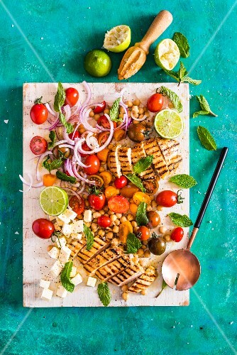 A salad with grilled chicken, honey and lime