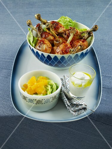 Crispy roasted chicken drumsticks with a dip