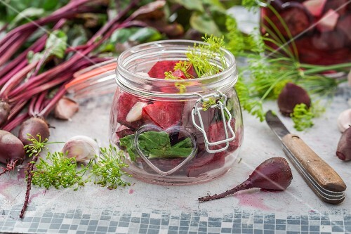 Fresh and pickled beetroot on a garden table