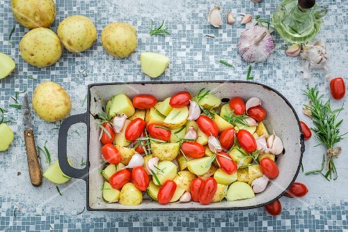Baked potatoes with tomatoes, garlic and rosemary