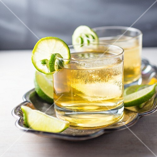 A cocktail with limes and ice cubes