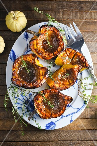 Roasted pumpkin with thyme on a plate