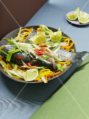 Steamed loup de mer with vegetables and lime