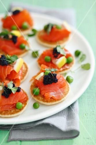 Blinis with smoked salmon, caviar and green peas