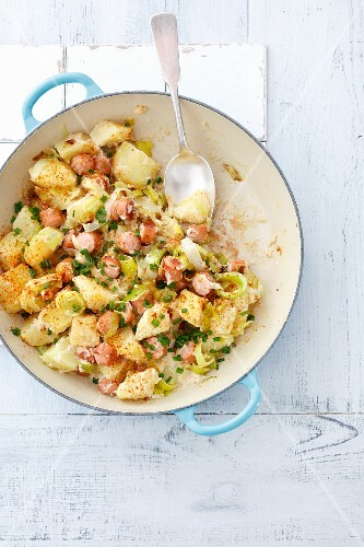 Potatoes fried with leek and sausage and served with horseradish sauce