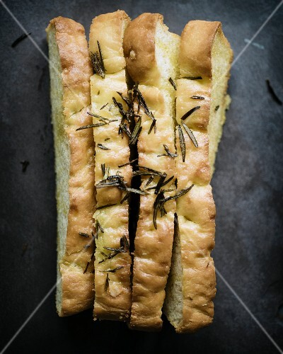 Long slices of foccacia with rosemary and sea salt (seen from above)