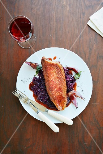Roast breast of goose on a bed of red cabbage