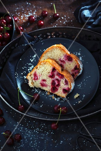 Two slices of vegan coconut Bundt cake with sour cherries