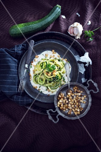 Courgette pasta with smoked tofu on a bed of carbonara sauce (vegan)