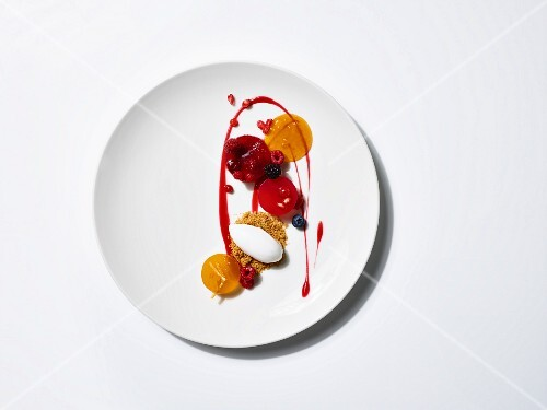 Raspberry jelly and coconut sorbet on a bed of crumble with kumquat