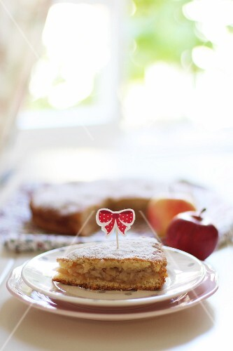 Filled apple cake decorated with a topper