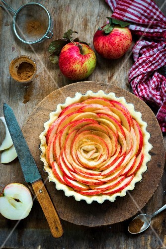 An unbaked apple and frangipane tart in a pastry case (top view)