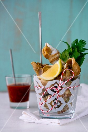 Whelks in a glass with lemon, parsley and New England seafood salsa