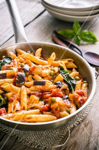 Penne with cheese, aubergine and tomatoes